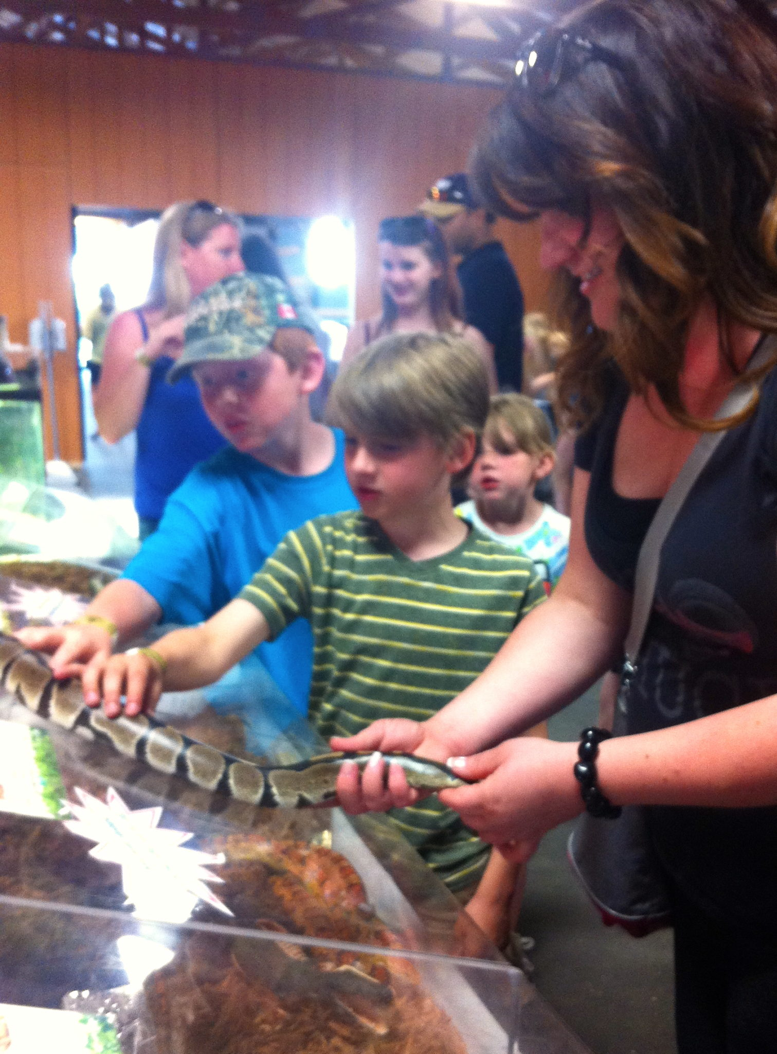 Me holding a snake with a couple of kids.