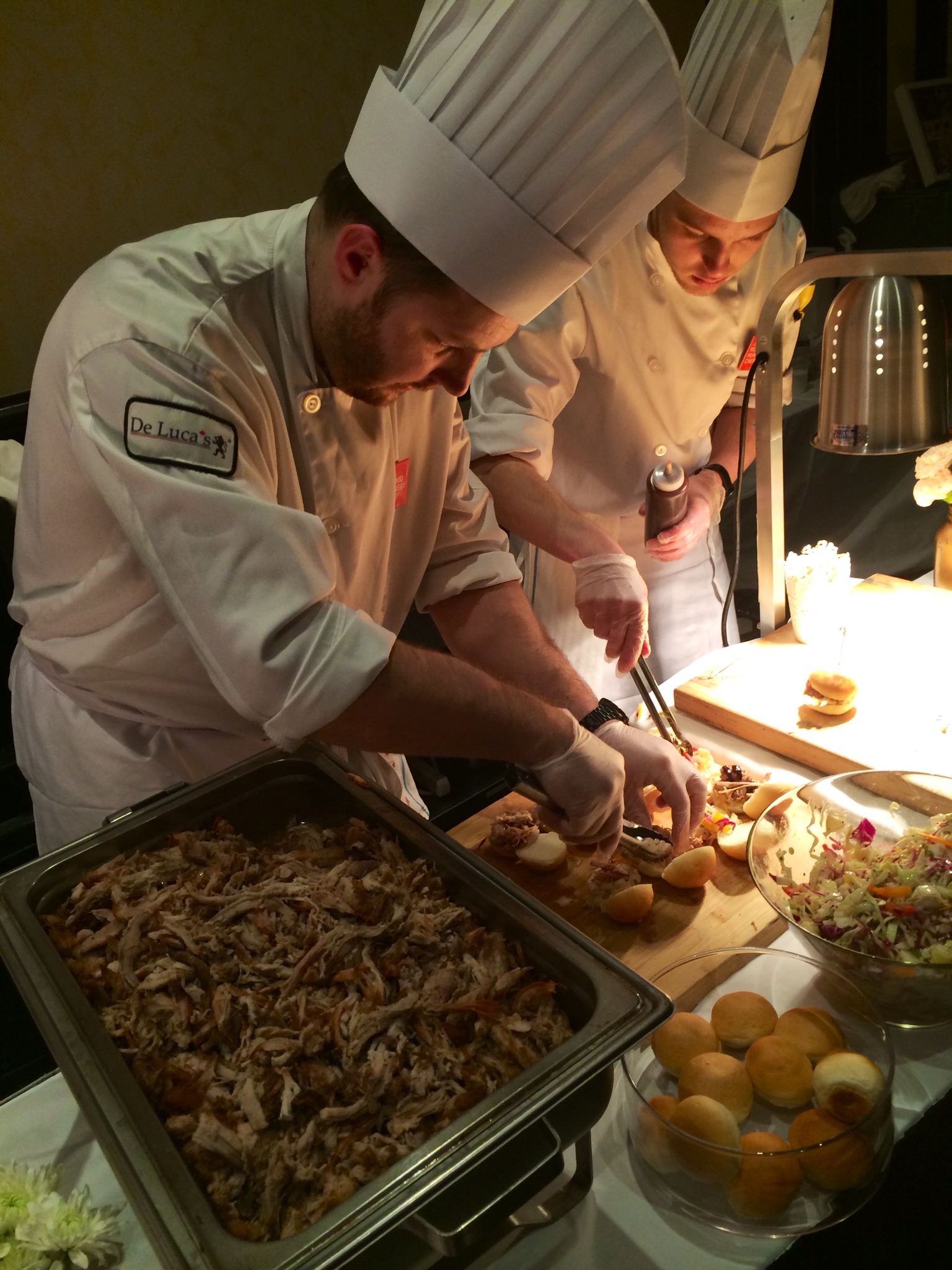 De Luca's chefs making delectable goodies.