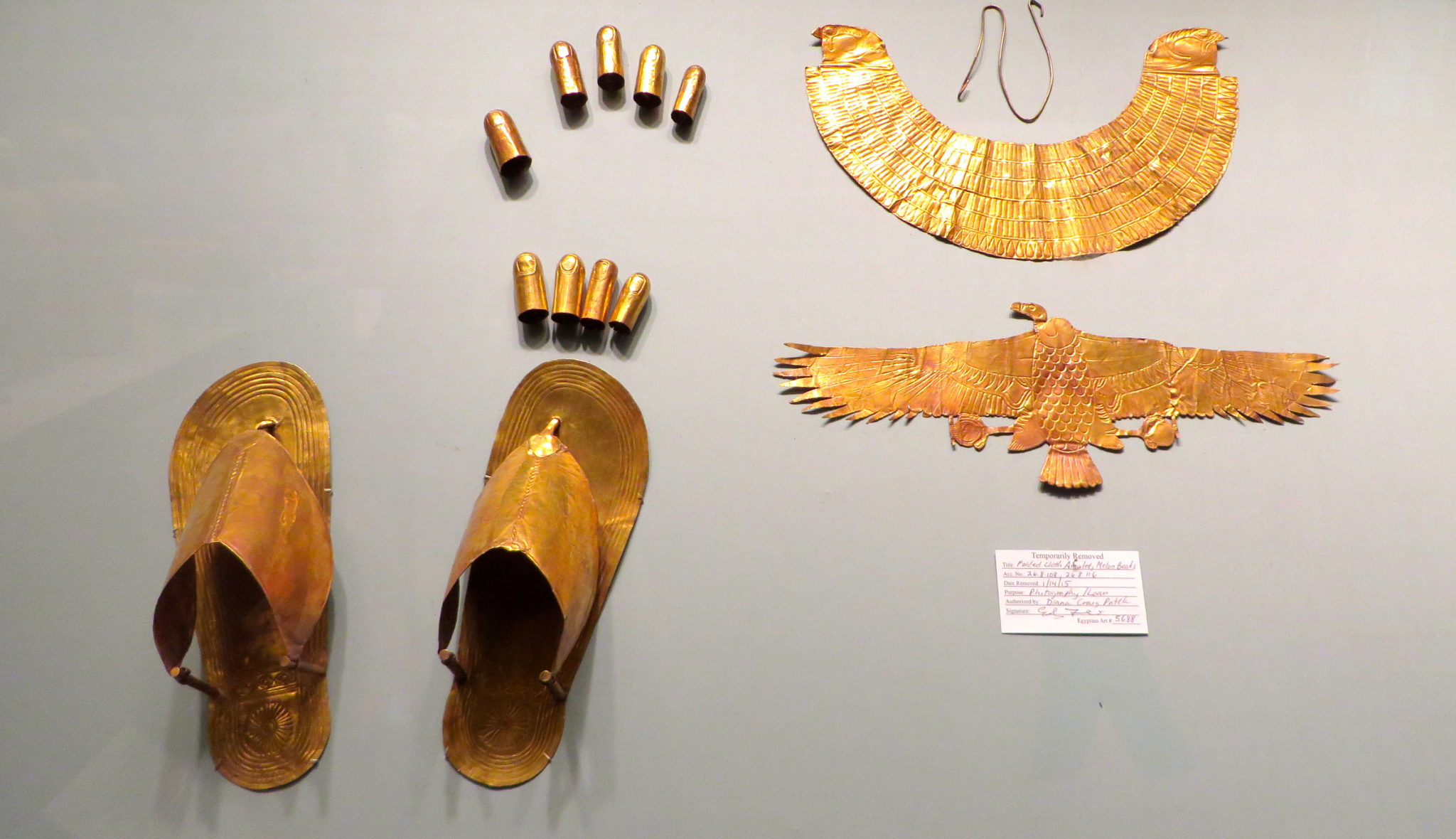 Gold sandals, finger stalls, toe stalls, broad collar with falcon-head terminals, and vulture pectoral. 1479–1425 B.C. Egyptian Art.